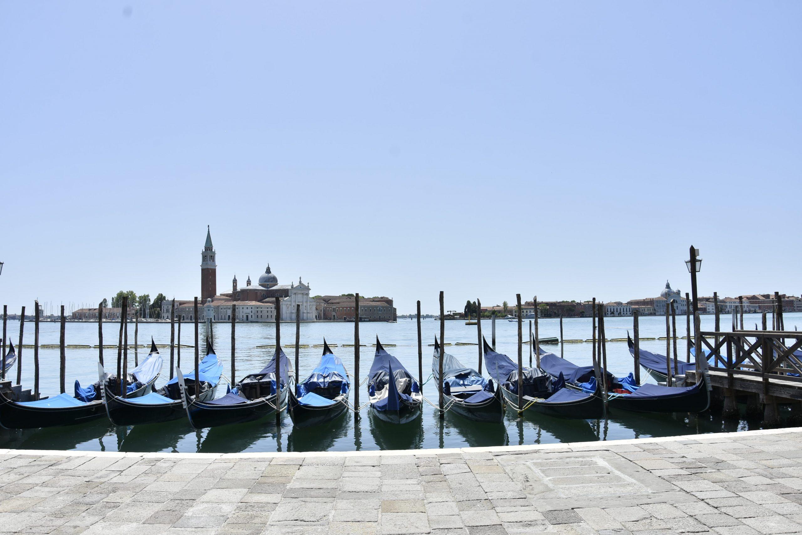 Venetian gondolas without people blue sky