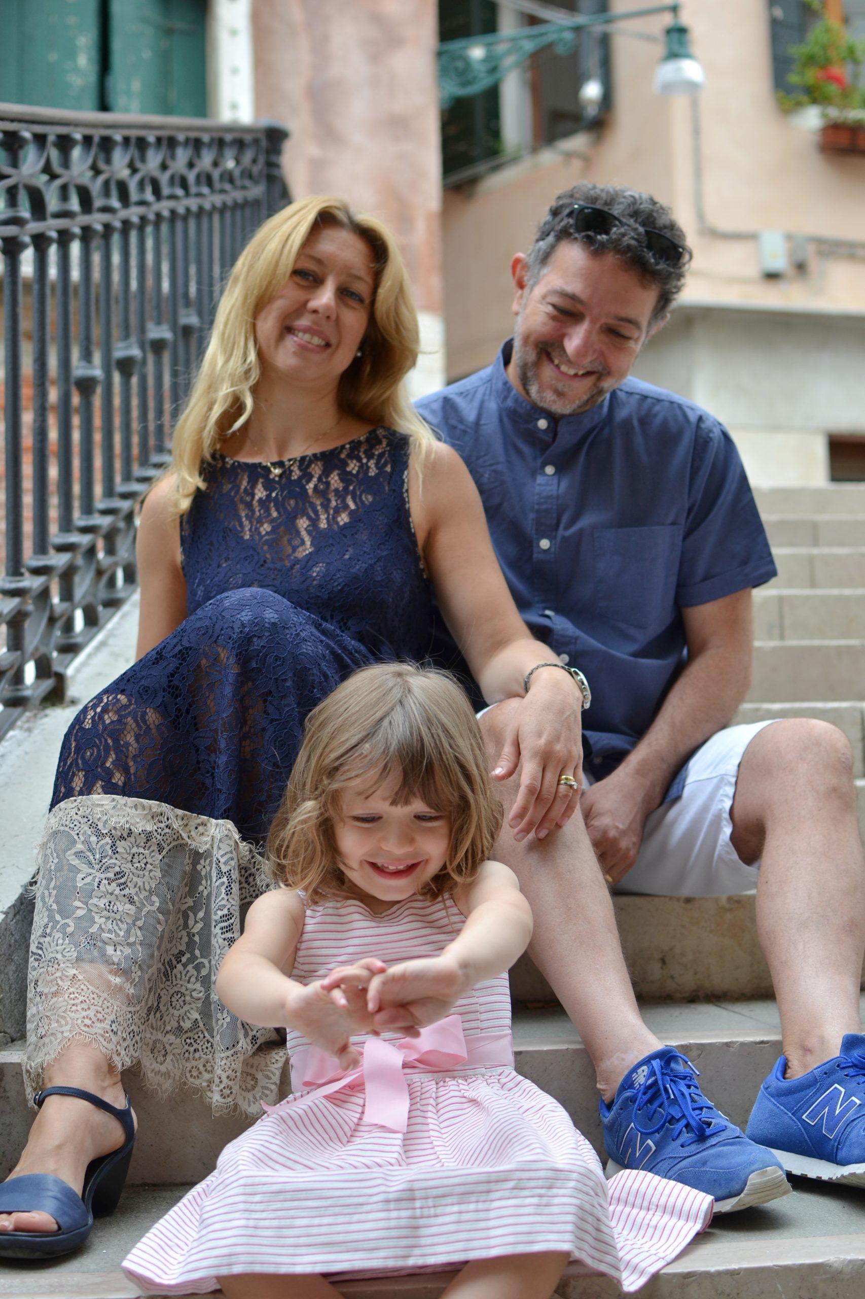 family sat in a bridge in Venice